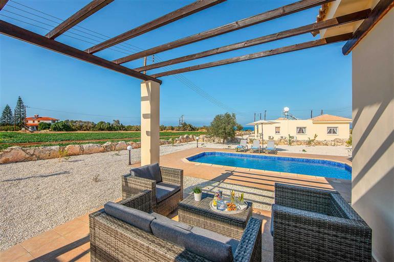 Garden and pool at Orange Tree Villa, Latchi