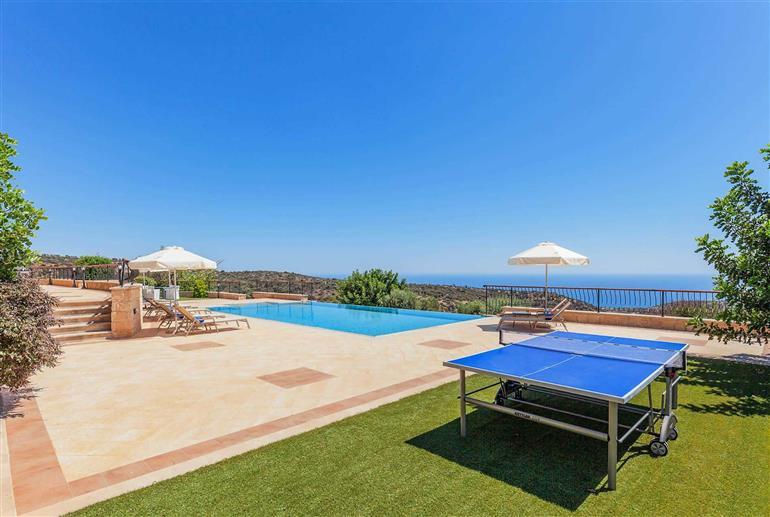 Garden and swimming pool at Villa Aphrodite Hills Elite 195, Aphrodite Hills
