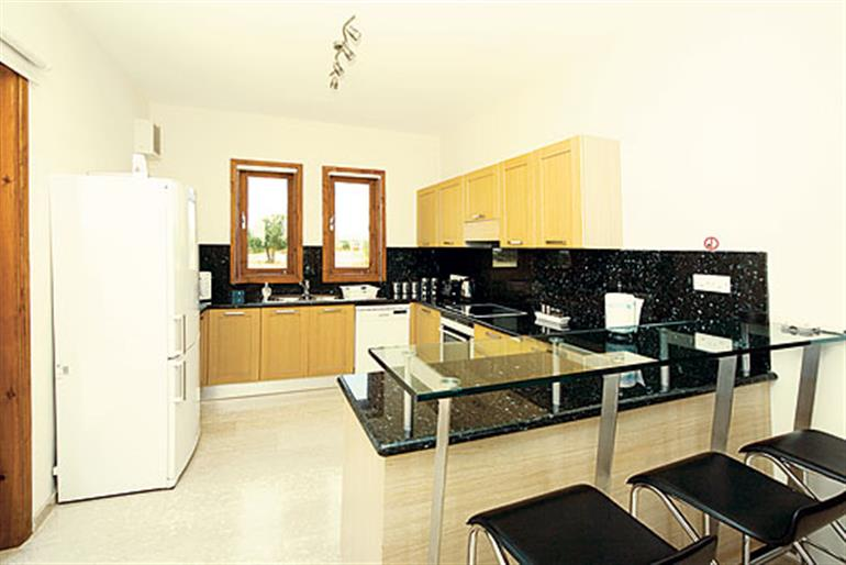 The kitchen in Thalia, Aphrodite Hills